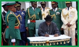 President Goodluck Jonathan, signing the anniversary register, during the Presidential Change of Guards Parade, at the Presidential Villa in Abuja, yesterday