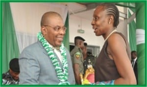 Acting Chief Judge of Rivers State, Justice Peter Agumagu (left) exchanging pleasantries with the state Education Commissioner, Dame Alice Lawrence -Nemi at the Nigeria's 53rd Independence Anniversary celebration in Port Harcourt, last Tuesday