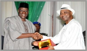 Vice President, Namadi Sambo (right), presenting an award to Governor Abdulfatai Ahmed of Kwara State during the 2013 World Teachers' Day celebration in Abuja last Saturday