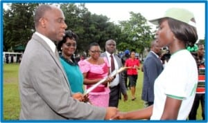 Governor of Rivers State, Rt. Hon. Chibuike Rotimi Amaechi (left), presenting a certificate to Scholastica Orji , during the passing-out ceremony of 2012 Batch 'C' NYSC members  in Port Harcourt, last Thursday.