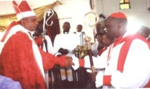 Newly consecrated Bishop of Opobo Diocese of Christ Army Communion Mission, Venerable Festus Oko-Jaja (right) in a handshake with the Archibishop of the Diocese, Dr. I. T. S. Anyanasikike, during the consecration in Port Harcourt, recently.