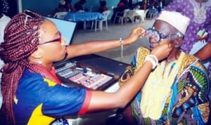 An old man testing his sight at Adeoyo hospital during World Sight Day celebration in Ibadan, recently   Photo: NAN