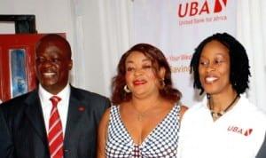 L-R: United Bank for Africa (UBA) Director of Consumer Banking, Mr Ilesanmi Owoeye, a customer, Ms Gladys Ugwuagu and Uba Head, Retail Products Division, Mrs Olumide Osunyomi during UBA launch of U-Gold Banking Product in Enugu, last week. Photo: NAN