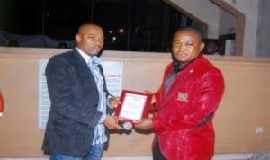 Lexy M (right) receiving an award