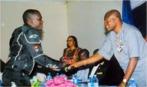 Sir Tony Okocha (right) in a handshake with the Kirikata Master, Oba Omega.