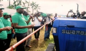 Rivers State Commissioner for Agriculture, Hon Emmanuel Chindah (left), commissioning a tractor donated by NDDC to Rivers State Government, during the 2013 World Food Day celebration in Port Harcourt recently.