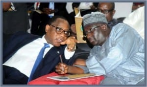 Minister of Industry, Trade and Investment,  Dr Olusegun Aganga  (left),  with  Minister of Transport,  Senator Idris Umar,  at the 2013 Nigeria Oil and Gas Trade and Investment Forum in Port Harcourt, last Thursday