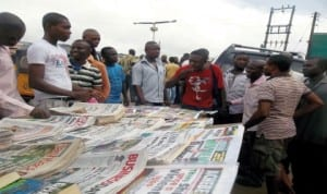 Free readers debating issues reported in newspapers displayed at a vendor stand at Alwell Bus Stop, Umuwaya Road, Umuahia, recently.