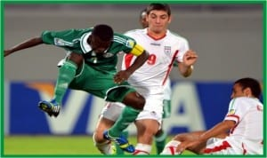 Golden Eaglets captain, Musa Yahaya (left) in action against Iran, recently.
