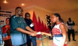Senator representing Rivers South East Senatorial District, Senator Magnus Abe (left) present a cheque of fifty thousand naira N50,000.00 to Miss Patience Jaja (right) during the Anual Presentation of Finance Support to Law Students going for Law School from the District last Monday in Port Harcourt. Photo: Chris Monyanaga.