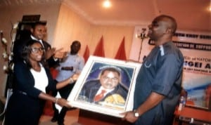 Senator representing Rivers South East Senatorial District in the National Assembly, Senator Magnus Abe (right), receiving a portrait from a beneficiary, Barrister Waamene Nwineewii, during the presentation of grants to his constituents proceeding to the Law School in Port Harcourt, last Monday.