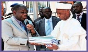 Minister of Power, Prof. Chinedu Nebo (left), handing over Abuja Distribution Company to the Chairman, New Core Investor, KANN Consortium Utility Company Ltd, Alhaji Shehu Malami, in Abuja  last Friday