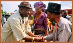 Rivers State Deputy Governor, Engr Tele Ikuru (left) in a handshake with former Deputy Governor of the State, Dr. Dominic Anucha, during the traditional marriage of the latter's daughter, in Amaji, Omuma LGA, last Saturday . With them is former Rivers State Head of Service and wife of Dr Anucha, Mrs Esther Anucha (middle).