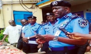 Commissioner of Police, Edo, Mr Foluso Adenajo (right), briefing newsmen on the arrest of 29 suspected criminals in Benin, recently. Photo: NAN