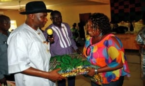 Senator Magnus Abe making a symbolic presentation of wrappers to the Leader, Andoni Legislative Assembly, Hon. Charity Wellington during a visit to the area recently. Photo: NAN