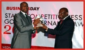 Rivers State Governor, Rt. Hon. Chibuike Rotimi Amaechi (left), receiving the BusinessDay Newspaper Best Governor in Education Development Award from the Publisher of BusinessDay Newspaper, Mr Frank Aigbogun, at Federal Palace Hotel, Victoria Island, Lagos, Wednesday.