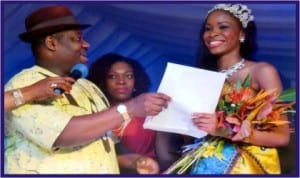 Rivers State Deputy Governor, Engr Tele Ikuru, presenting car particulars and key to the winner of 2013 Miss Port Harcourt Centenary Beauty Pageant, Miss Theodora Kelechi Atako (right), at Hotel Presidential, Port Harcourt, last Friday. With them is wife of the Deputy Governor, Mrs Mima Ikuru. Photo: Nwiueh Donatus Ken
