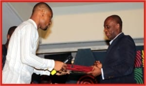 Rivers State Governor, Rt. Hon. Chibuike Rotimi Amaechi (right), receiving an award from Mr Alex Ekubo during the pre-award dinner for Best of Nollywood Award nominees held in Government House, Port Harcourt, last Sunday.