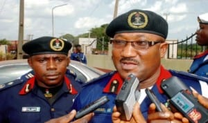 Deputy Commandant, Nigeria Security and Civil Defence Corps, Enugu Command, Mr. Dan Samuel (left), with his Commandant, Mr. Nathaniel Ubong, addressing newsmen on armed robbery suspects paraded by the command in Enugu, recently. Photo: NAN