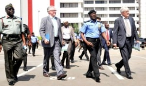 R-L: Nigerian Defence Attache To Sudan, Maj.-Gen. Suleiman Aliyu, Senior Adviser, Norwegian Ministry of Foreign Affairs, Dr Kjell Hodnebo, IGP, Mohammed Abubakar and Norwegian Ambassador to Nigeria, Mr Rolf Ree, during a tactical demonstration by a Nigeria Police Unit in preparation for peace  keeping to Liberia and Sudan  in Abuja 'yesterday. Photo: NAN