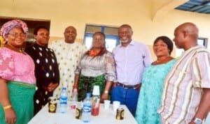 Advert Manager, Lagos office of The Tide Newspapers, Mrs. Myne Dickson (middle), with staff of RSNC and other guests,  at the dedication of her grand child in Port Harcourt last Sunday. Photo: Chris Manyanaga