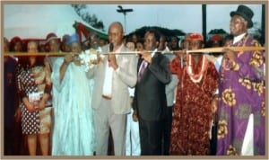 Representative of the Rivers State Governor and Commissioner for Commerce and Industry, Hon. Chuma Chinye (middle),  cutting the tape during the opening of the 9th Port Harcourt International Trade Fair in Port Harcourt last Friday. With him are National President, NACCIMA, Alhaji Mohammed Badaru Abubakar (2nd left), HRM Alfred Diete-Spiff (right) and other dignitaries.   Photo: Egberi A. Sampson