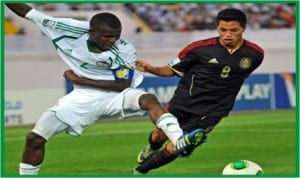 Kelechi Iheanacho (left) being pulled down by an opponent during one of the matches in the just-concluded U-17 World Cup
