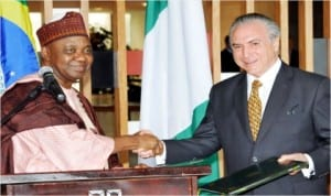 Vice President Namadi Sambo (left), exchanging a signed Bilateral Agreement with the Brazilian Vice President, Mr Michel Temer, at the Itamaraty Palace in Brazil last Tuesday.