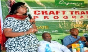Representative of the Director-General, Nigeria Tourism Development Corporation (NTDC), Mrs Patricia Ewuzie (left), addressing participants during a crafts training programme in Degema, Rivers State last Monday. With her are organiser of the programme and member, representing Degema/Bonny Federal Constituency in the National Assembly, Dr Sokonte Davies (right) and representative of Chairman, Degema LGA., Mr Ambille Belema
