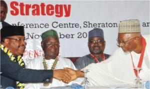 Representative of the President, Chief Mike Onolememen (left), being congratulated by the President, Architects Registration Council of Nigeria, Mr Umaru Aliyu (right), at the 53rd General Assembly Conference of Nigerian Institute of Architects in Abuja, recently. With them are Minister of Mines and Solid Minerals, Mr Musa Sada (2nd right), and 24th President, Nigerian Institute of Architects, Mr Ibrahim Haruna.
