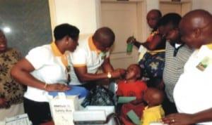 Garden City Lions Club, Port Harcourt immunising children against Measles