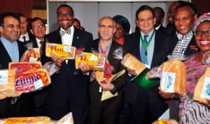 Secretary-General, D-8 Organisation for Economic Cooperation, Mr Seyed Mousavi (left), Minister of Agriculture and Rural Development, Dr Akinwumi Adesina (3rd left), and other delegates, displaying cassava bread, at the 4th D-8 Agricultural Ministerial Meeting on Food Security in Abuja last Friday. Photo: NAN
