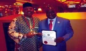 Mayor of Maryland and President of US Mayors' Conference, Dr James Walls (left), presenting an Award to Director General, NAFDAC,  Dr. Paul Orhii in Milwaukee, USA  recently. Photo: NAN