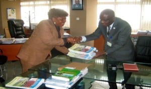 Rivers State Head of Service,  Barr.  Samuel LongJohn (right), receiving some copies of the Rivers Bureaucrat from Chairman, Editorial Board and Permanent Secretary, Ministry of Commerce and Industry, Ms Kadilo Brown in Port Harcourt, recently.