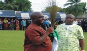 Rivers State Commissioner for Works, Victor Giadom (left), flanked by former Gokana Council Chief of Staff, Second Bakor with APC flag and broom, addressing Gokana people at a rally in Kpor, recently.