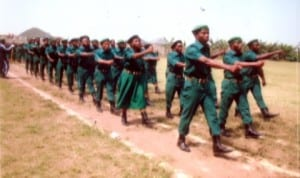 The Tide staff, Roseline Wosu (2nd left), with newly commissioned officers of the Nigeria Legion, Rivers State Command, Zone A, on parade, during the passing out ceremony and inauguration at Deeper Life High School Sports Complex, Port Harcourt last Saturday.