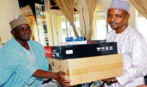 Chairman, Nuj, Bauchi State Council, Comrade Dahiru Mohammed (right), presenting a set of  computer to the State Commissioner for Information, Alhaji Mohammed Dhamina, in Bauchi, recently. Photo: NAN