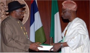 Chairman, Presidential Advisory Committee on National Conference, Dr Femi Okuronmu (right), presenting the report of the committee to President Goodluck Jonathan at the Presidential Villa in Abuja last Wednesday