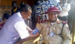 Unit Commander, FRSC Ogere Unit, Mr Godwin Sangbasa, being screened during health screening for drivers at Ilishan-remo Motor Park, Ogun, during  the ember months campaign last Thursday.