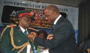 Governor Chibuike Amaechi decorating King (Col) Philemon Chindah Omunakwe (rtd) Chairman Nigerian Legion, Rivers State, during the 2014 Armed Forces Emblem Appeal Launching in Port Harcourt, last Tuesday.