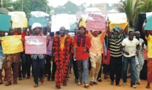 Youths from Ezinano community of Awka protesting the alleged sale of their land by land speculators in Awka, yesterday.