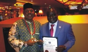Dr James Walls Mayor of Maryland and the President of US Mayors' Conference presenting award to DG NAFDAC, Dr. Paul Orhii at a ceremony in Milwaukee, USA