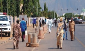 Workers resuming from New Year holiday at the Federal Secretariat in Abuja, yesterday.