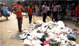 Cleaning of Balogun Market after the Christmas and New Year celebration In Lagos On Friday