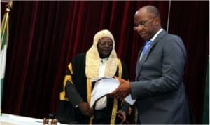 Rivers State Governor, Rt. Hon. Chibuike Rotimi Amaechi presenting the 2014 Budget Appropriation to the Speaker of the State House of Assembly, Rt. Hon. Otelemaba Dan-Amachree.