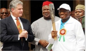 L-R: British High Commissioner to Nigeria, Dr Andrew Pocock; Secretary to the Government of the Federation, Sen. Anyim Pius Anyim; President  Goodluck Jonathan and Minister of Special Duties, Alhaji Tanimu Turaki, during the arrival of torch of the 20th Commonwealth Games, Glasgow 2014 in Abuja on Monday.