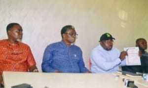 Chairman, Save Rivers Movement, Barr. Aholu O. Charles (2nd right), showing journalists the police permit given to the movement before the rally in Port Harcourt last Sunday. With him are former House of Representatives member and member of the body, Hon Igo Aguma (2nd left), Chairman, Bonny Local GovernmentArea of Rivers State, Barrister Edward Pepple (left) and a member of the Movement, during a press briefing on the aborted rally organised by the group in Port Harcourt, yesterday. Photo: Chris Monyanaga