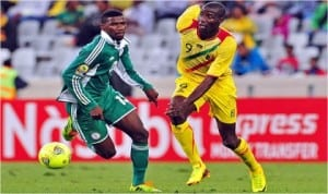A Super Eagles player being pressurised by a Malian opponent last Saturday