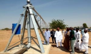 Governor Kashim Shettima of Borno State (3rd-left),inspecting a unit of Centre Pivot Irrigation Equipment, being installed by an American Agro Firm at a farm site on Maidugurikonduga Road under the gricultural transformation programme recently. The unit moves in circle to water crops in dry Season. Photo: NAN