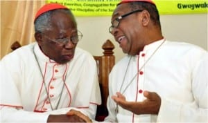 Francis Cardinal Arinze, the Prefect Emeritus, Congregation for Divine Worship and the Discipline of the Sacraments (left), with the Archbishop of Abuja Catholic Diocese, John Cardinal Onaiyekan, at the 2014 annual St. Paul Lecture Series In Abuja On Saturday